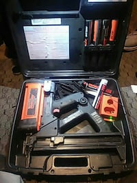black and orange cordless air nail gun with case and battery charger McMinnville, 97128