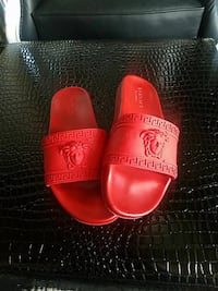 pair of red Versace rubber slide sandals
