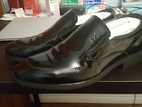 pair of black leather Playboy slip-on shoes