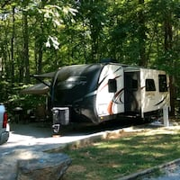 black and gray camping trailer 52 km