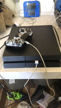 black Sony PS4 console with controller Los Angeles, 90044