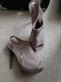 pair of gray leather peep toe platform stilettos Waldorf