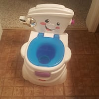 toddler's white and blue Fisher-Price potty trainer