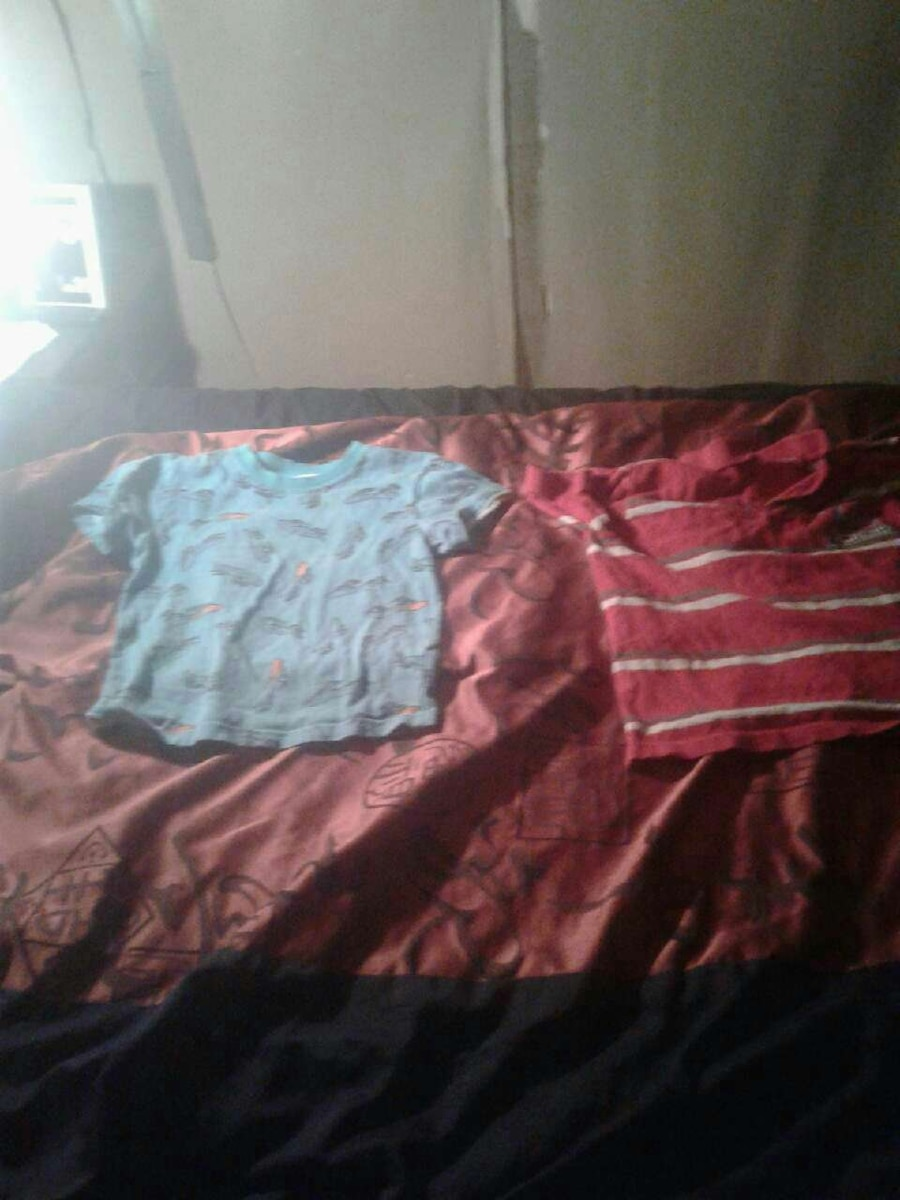 two blue and red crew neck shirts