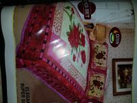 pink and multicolored bed sheet set 28 km