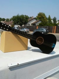 black and gray acoustic guitar Sacramento