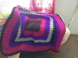 square purple, white, and black crochet cloth