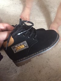 Pair of toddler's black leather boots Winnipeg, R2W 1K9