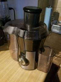 Stainless steal and black power juicer. Edmonton, T5T 4L9