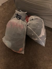 3 bags full of plus size woman's and some men's clothing. 41 mi