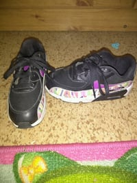 pair of black-and-pink Nike running shoes El Paso, 79924