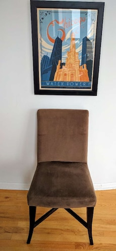 Brown suede and wooden chair