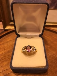 Beautiful! Gold Purple gem stone Ring with surrounding White Diamond crystals Gainesville, 20155