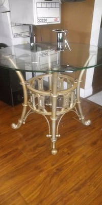 side table heavy with thick glass beveled