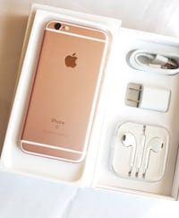Gold and silver iphone 6s with earpods and charger 31 km