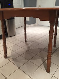 Round brown wooden kitchen/dining table