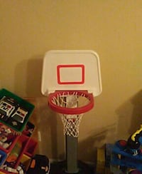 white and red toy basketball goal