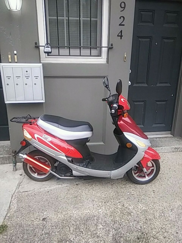 red and white motor scooter