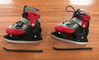 Pair of black-and-red boy  ice skates Bristow, 20136