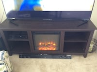 black wooden TV stand with flat screen television Rockville, 20850