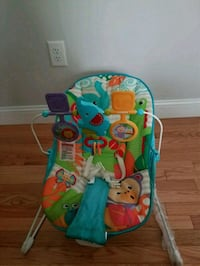 baby's blue and green Fisher-Price bouncer 410 mi