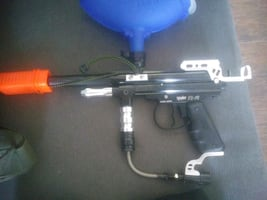 Spyder tr-l. Paintball gun with mask and extra ball carriers.