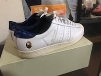 pair white-and-blue BAPE athletic shoes with box