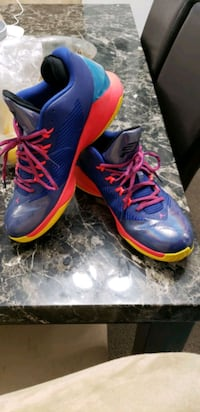 pair of blue-and-red Nike basketball shoes Kelowna, V1X 7H4