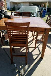 brown wooden dining table set 1942 mi