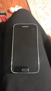 Samsung galaxy s5 in great condition nothing wrong is the battery cover is gone but can be replaced for a couple of dollars but works perfectly
