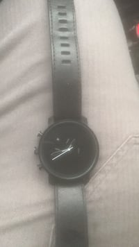 round black analog watch with black leather strap Elkhart, 46514