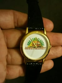 Round gold-colored analog watch with black leather strap