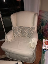 Wingback chair with brown wooden base
