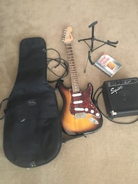 Fender Squire Sunburst guitar. Includes, amp, stand, case, all cords, and a instruction book on cords