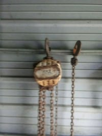 two brown wooden pendant necklaces 994 mi