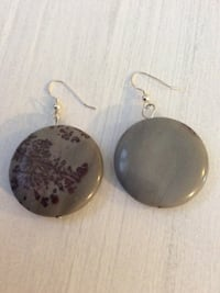 pair of round grey and black hook earrings