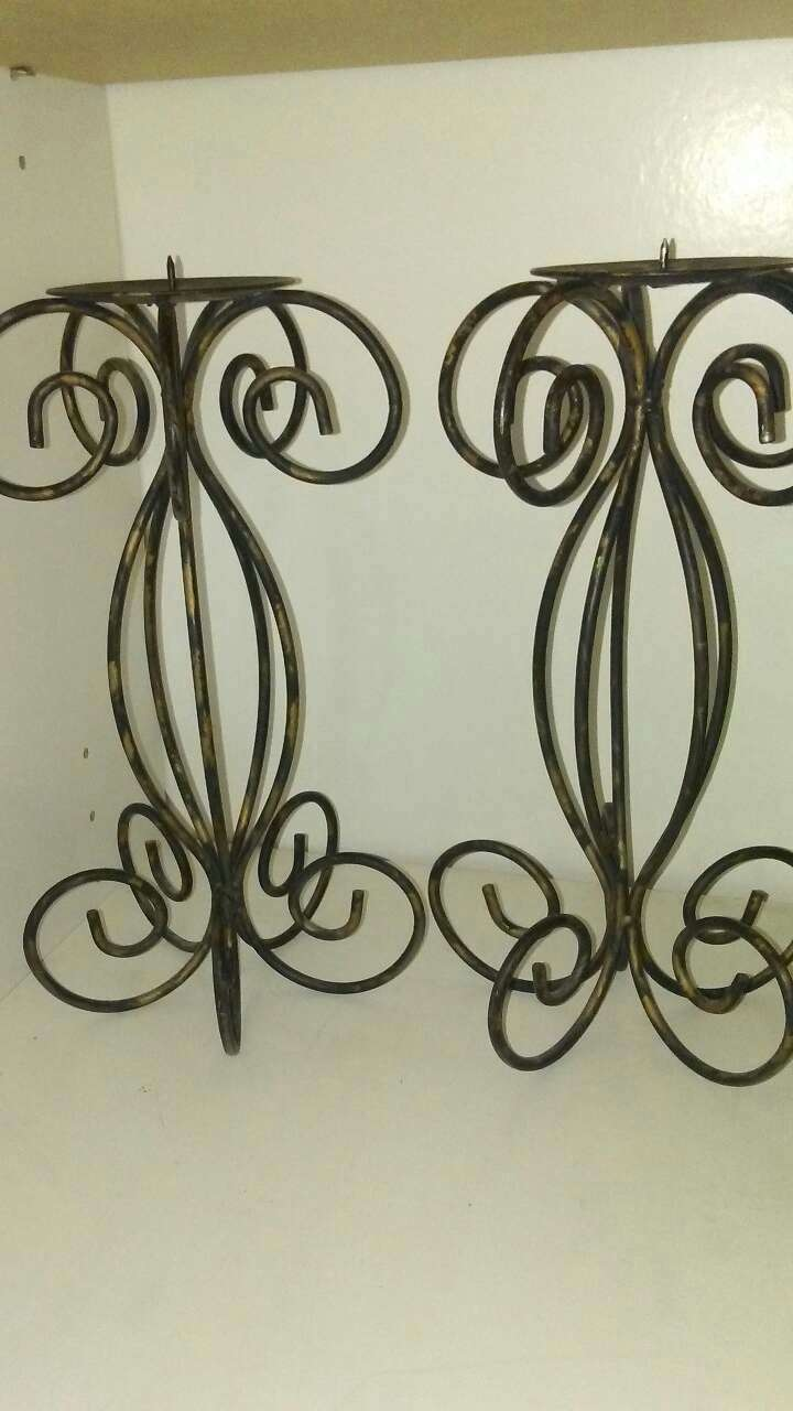 two black  iron candle holders