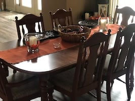 Table with 2 captain chairs, 4 others! Hutch with a light! Both pieces