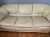 beige leather 3-seat sofa. Worn but extremely comfy!  Fairfax, 22032