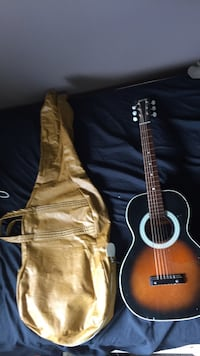 Brown and black acoustic guitar North Battleford, S9A 3J3