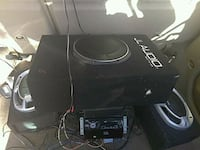 Jl 10 jvc rciever and alpine amp mounted on rear a