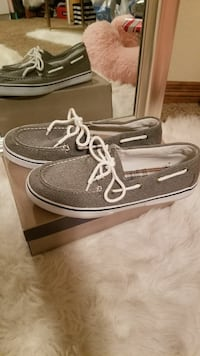 pair of black boat shoes with brown box Fort Collins