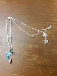 real silver dalphin penant with real crystals. comes with chain.  Bloomington