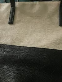 women's black and white Mary Kay leather tote bag