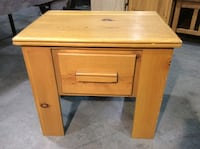 """Solid wood small side table with drawer. Some dings and scratches but very good used condition overall. Measures 22"""" x 16"""" x 19 1/2"""" tall"""