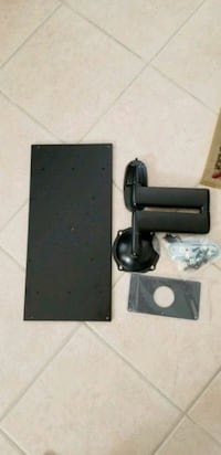 BRAND NEW T.V. WALL MOUNT