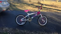 Pink and white bmx bike