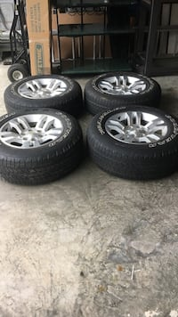 P265/65R18 Goodyear Wrangles with Rims 64 km