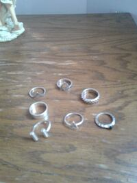 assorted silver-colored rings