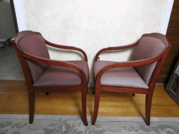 brown wooden framed padded armchair
